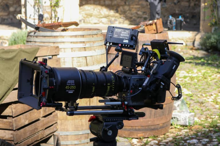 red weapon camera with arri lens on filmset